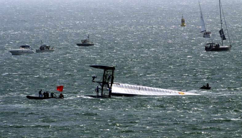 America's Cup World Series - Green Comm capsize - Plymouth Sound - © Ian Foster / fozimage